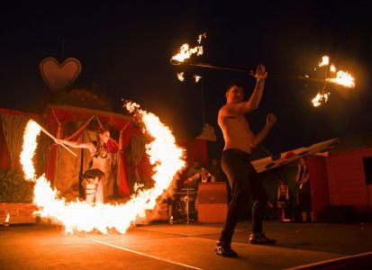 stage performers with fire